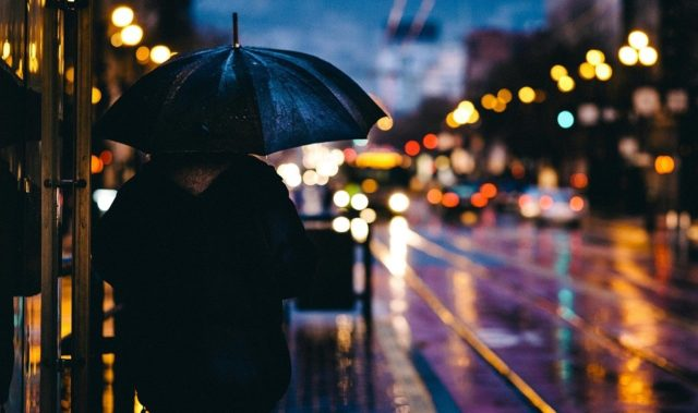 A person in a rain in the evening