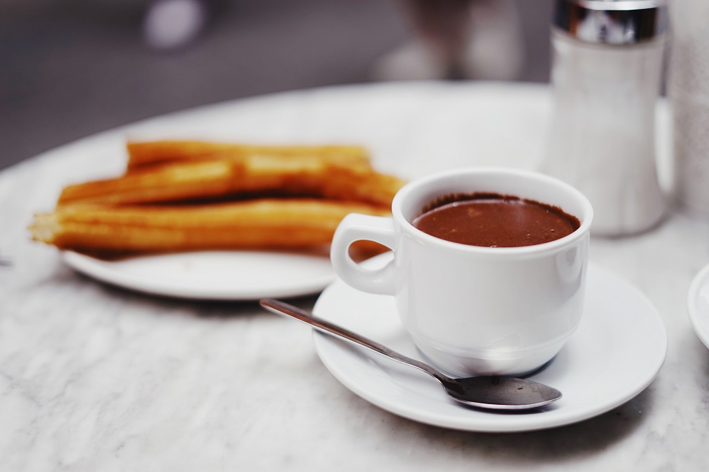 Cup of hot chocolate and churros