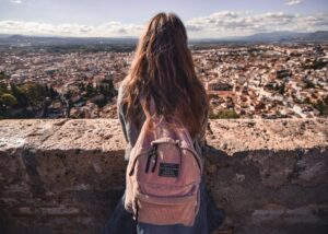 Girls enjoying the view of granada on top of a hill