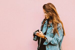 Girl looking on her camera