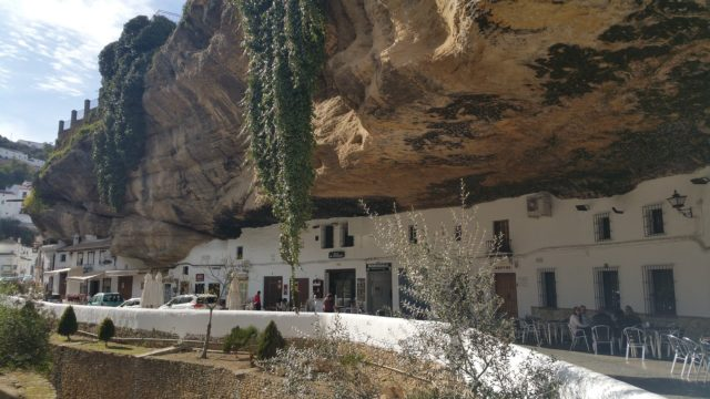 Main white houses that are located in the center of the city of Setenil and under the famous stone