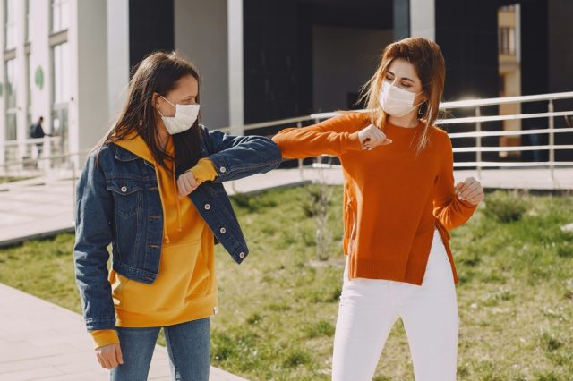 women walking in Spain during New Normal phase after Coronavirus outbreak